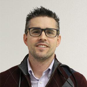 Headshot of Dr. Travis Charles