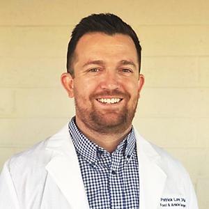 Headshot of Dr. Patrick Law